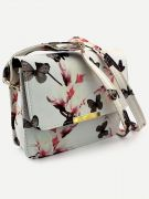 A white bag with a print of flowers and a butterfly-5