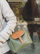 Large shoulder bag with long metal hand-1