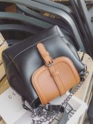 Large shoulder bag with long metal hand-4