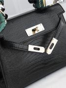 Leather bag with a golden metal clasp medium size-11