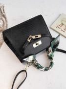 Leather bag with a golden metal clasp medium size-7