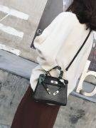 Leather bag with a golden metal clasp medium size-8