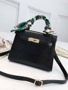 Leather bag with a golden metal clasp medium size-9