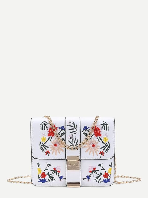 A white leather bag with a floral pattern