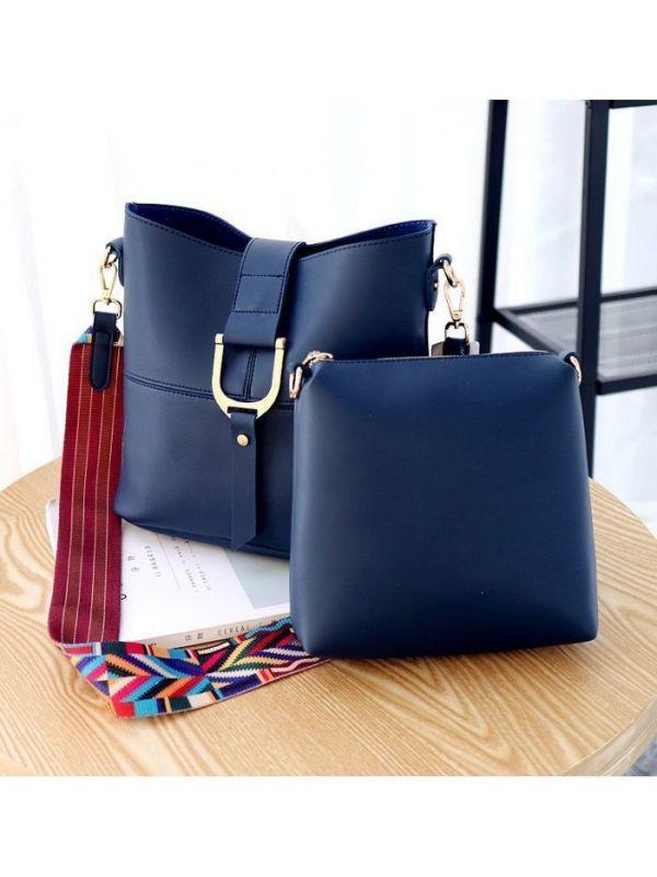 حقيبة كتف داخلها حقيبة صغيره