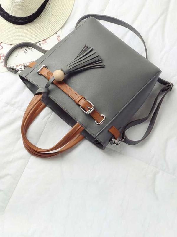 حقيبة يد سوداء بشريط جملي