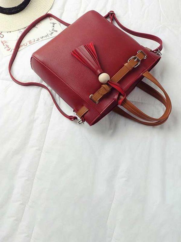 Black handbag with ribbon