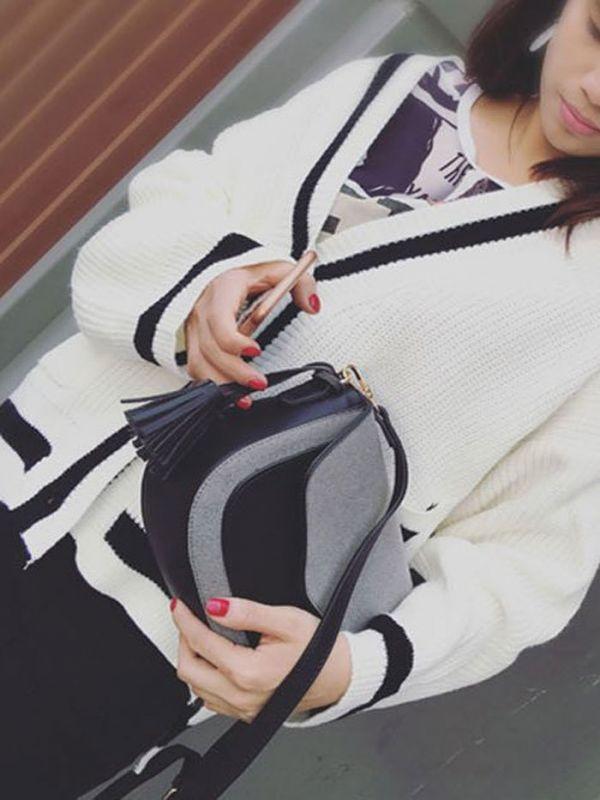 Shoulder bag with separate hand