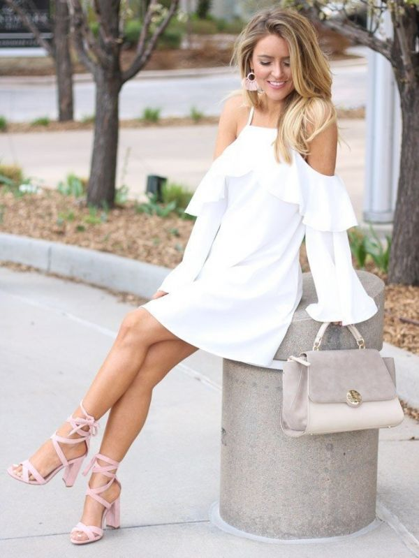 A white dress with open sleeves and a pouch on the sleeves