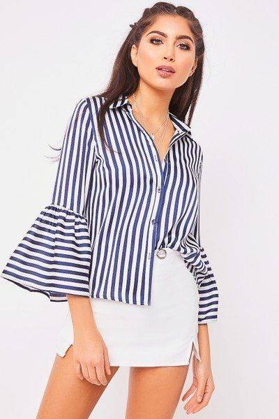 Blue and white curry blouse and several bells