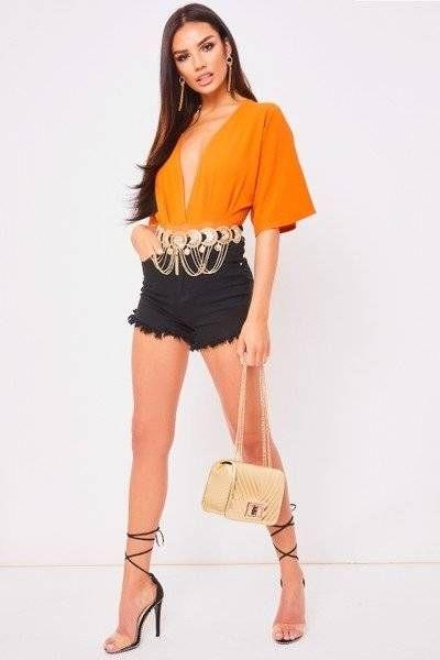 Orange halter blouse with details on sleeves