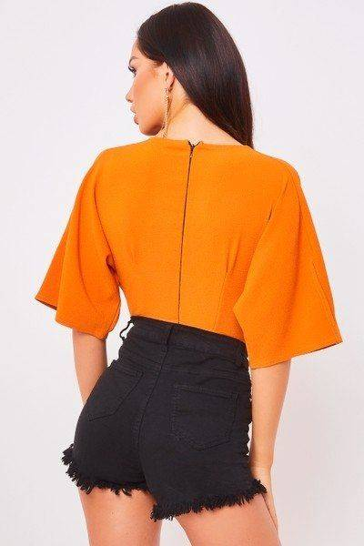 Orange halter blouse with details on sleeves