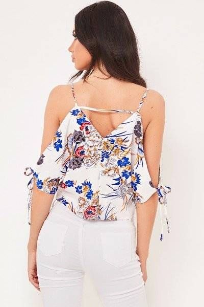A white blouse with a rose print