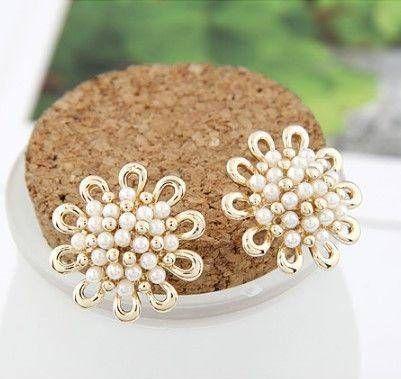 The golden rose earring is golden