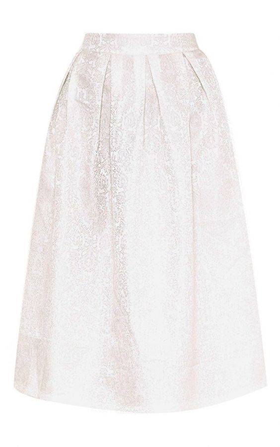 White skirt with ruffles and tassels