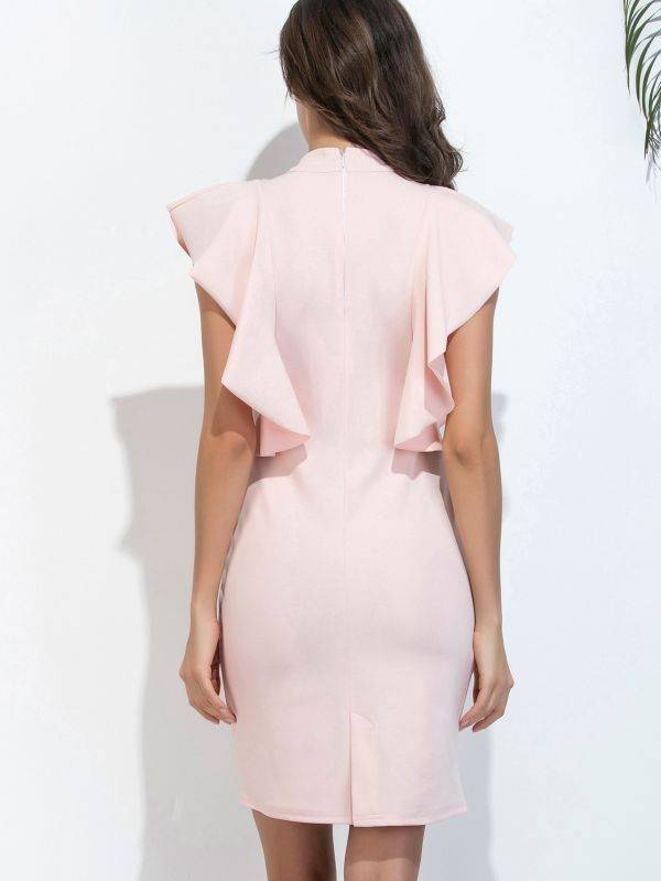 Dress the short pink color with ruffles from the sides on the chest