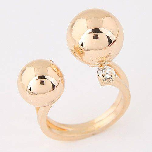 Ring with two gold balls