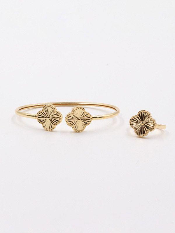Van Cleef Gold Flower bracelet and ring