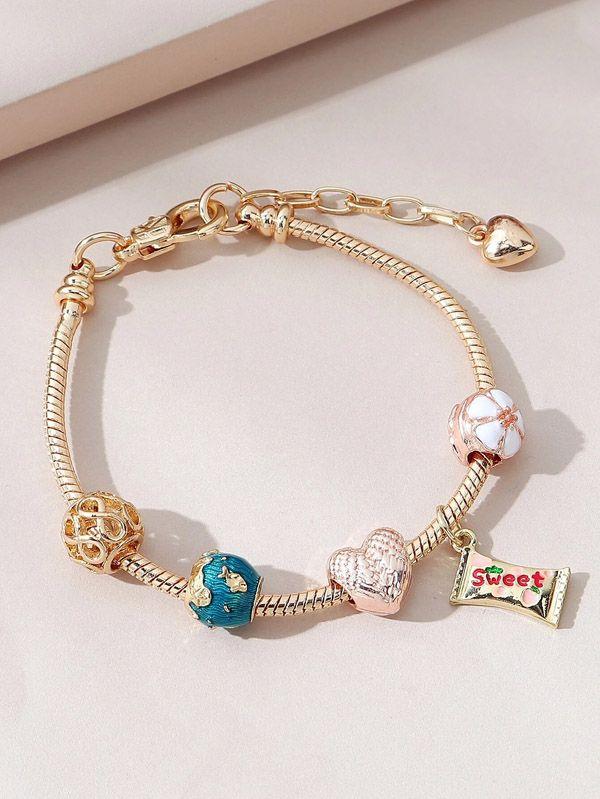 Pandora bracelet golden pendants