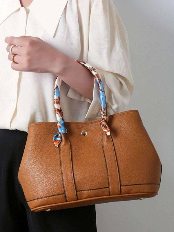حقيبة يد نسائية بني