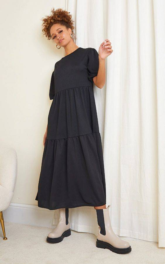A black midi dress with short puff sleeves
