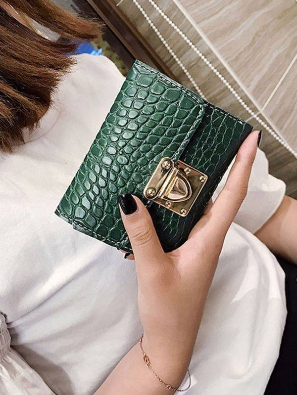 Wallet with a golden crocodile leather lock