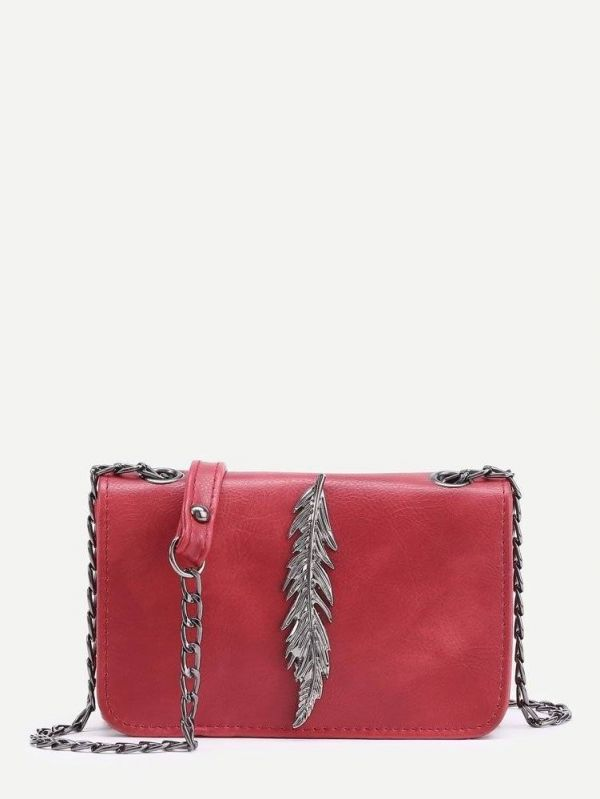 Shoulder bag decorated with metal leaf and chain
