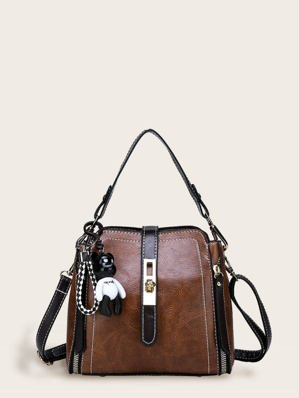 Luxury brown leather case with bear's attachment