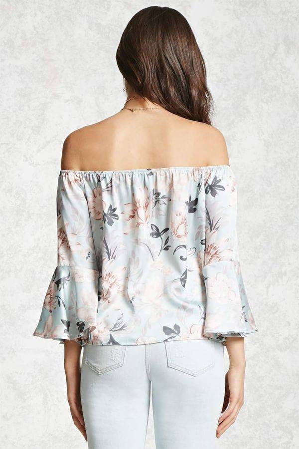 A blouse of satin with a floral print