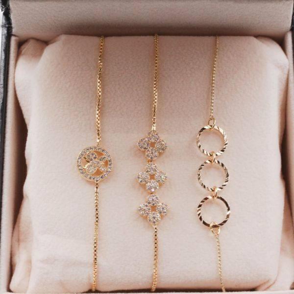 A set of gold zipper bracelets
