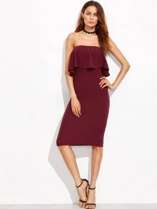 A tight-fitting burgundy dress with open-necked ruffles