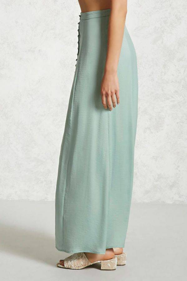 The satin skirt is a green olive-colored muxi